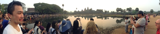 Crowds at sunrise over Angkor Wat
