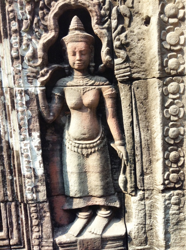 Most likely a Devata (Hindu deity)